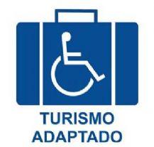 Imagem de mala com cadeira de rodas desenhada e a inscrição Turismo Adaptado
