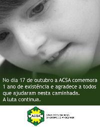 Cartão de aniversário de 1 ano da ACSA, onde vê-se um menino e o texto a seguir: no dia 17 de outubro a ACS comemora 1 ano de existência e agradece a todos que ajudaram nesta caminhada. A luta continua.
